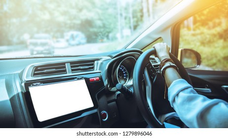 Woman hand holding the steering wheel a car. drive a car travel relax in the holiday. Driving skills a car