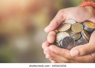 An woman hand, holding Stock pile of Hundred number 1, 2, 10, 5 Indian rupee metal coin currency. Financial, economy, investment concept.