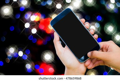 Woman hand holding and touch screen smart phone, tablet,mobile-phone on abstract blurred beautiful bokeh background.