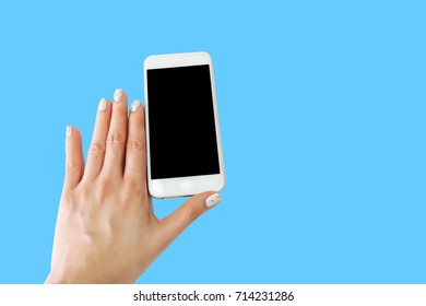 Woman Hand Holding and Touching Phone with Black Screen on Blue Background Great For Any Use.