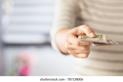 Woman hand holding USA Dollar bills