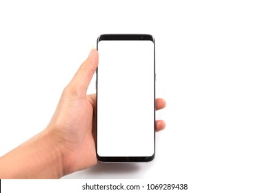 Woman hand holding and using new and modern smartphone with white screen, isolated on white background with clipping path top view.