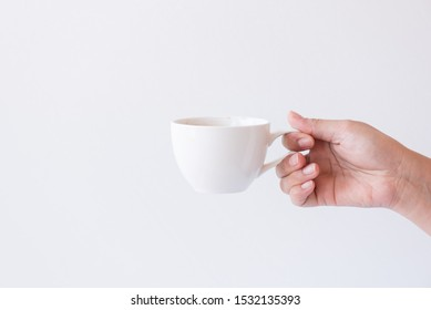 Woman hand holding white cup hot espresso coffee menu isolated on white background.Hot drink menu for customer in the coffee shop or restaurant.