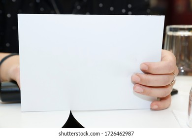 woman hand holding white paper