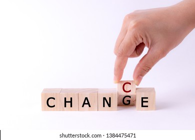 woman hand holding wooden cube with flip over block CHANGE to CHANCE word on withe table background. success, strategy, solution, business and Positive thinking concepts with space for advertisers.