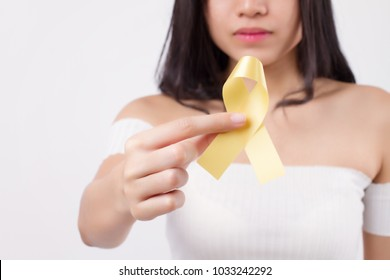 woman hand holding yellow ribbon bow, suicide, military forces, fire service, endometriosis awareness symbol, yellow ribbon for medical, charity fund raising concept