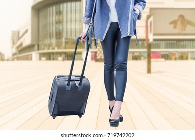 Woman with hand luggage in airport