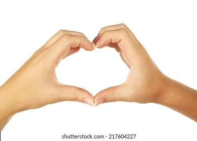 Woman hand making heart