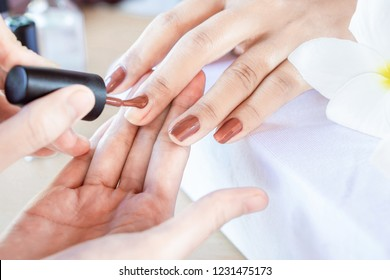 woman hand manicure in beauty and spa shop ,painting nail polish