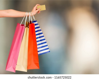 Woman hand with many shopping bag