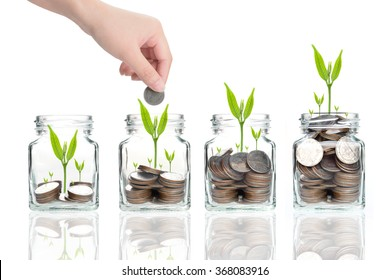 woman hand with money coins in clear bottle on white background,Business investment growth concept,saving concept,Hand putting coins and seed in clear jar over white background