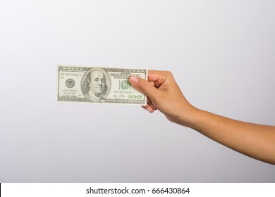 Woman hand with money isolated on white background