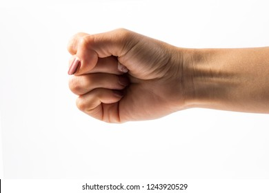 Woman hand on Isolated white background. Clenched fist.