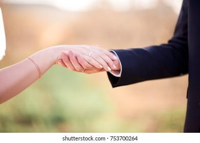 Woman hand on man hand closeup. Wedding day.