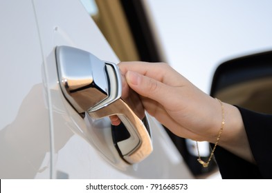 Woman hand open car door