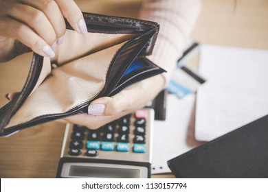 woman hand open empty purse looking for money,bankruptcy broke concept