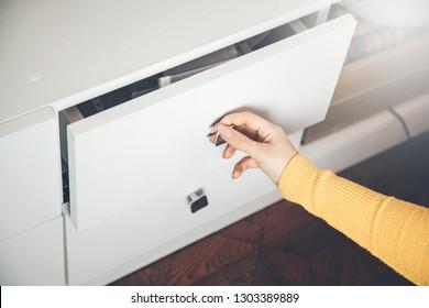 woman hand Open Kitchen Cabinet