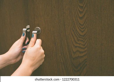 Woman hand open wardrobe use for background