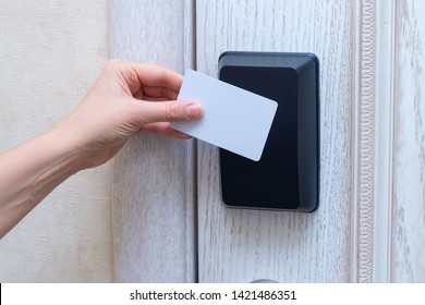 Woman hand openning hotel door with card