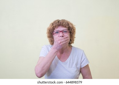 woman with hand over her mouth