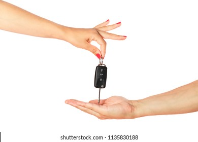 Woman hand passing to man hand car key isolated on white background