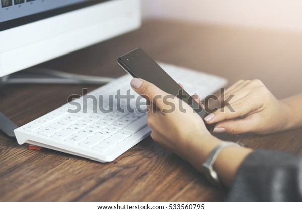 woman hand phone with working keyboard