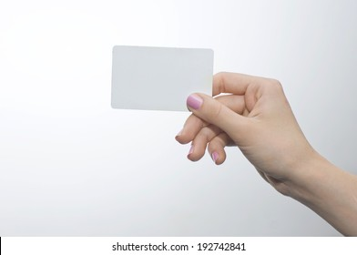Woman hand with pink nails holding credit card
