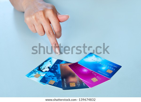woman hand pointing at collection of credit cards