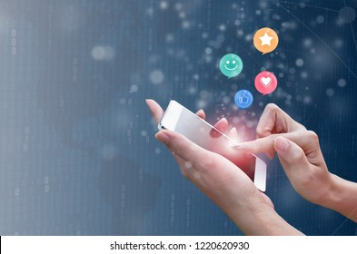 Woman hand pressing on smart phone with smiley face, like, love and star emoticon on virtual touch screen. Customer service evaluation concept.