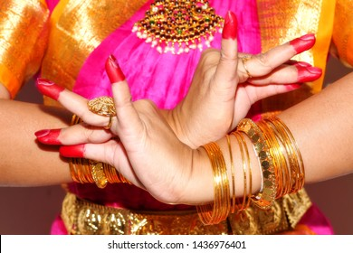 Woman hand of professional Indian dancer demonstrates dance mudra (gesture) of Bharatanatyam classical dance