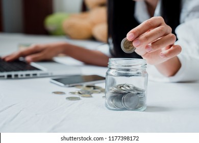 Woman hand putting Row and coin in jug grass and working with ca