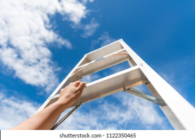 Woman Hand Reaching For Red Ladder Leading To A Blue Sky Step by Step. Development Attainment Motivation Career Growth Concept.