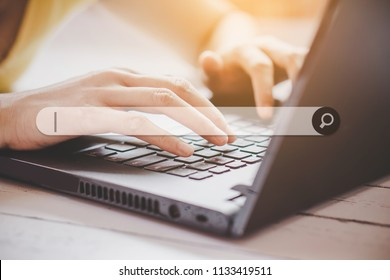 woman hand searching browsing internet data on computer notebook