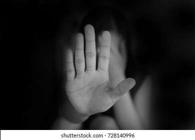 woman hand showing STOP violence against women, help me