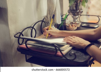 Woman hand signing guest book