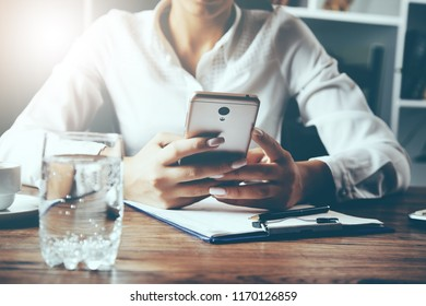 woman hand smart phone with document