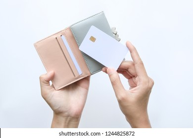 woman hand take out showing blank card for payment from pink wallet. Credit debit card with chip