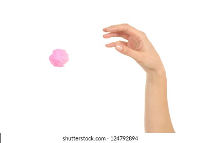 Woman hand throwing a paper on a white isolated background