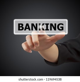 woman hand touching button banking keyword, on gray background