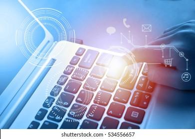 Woman hand touching laptop computer keyboard