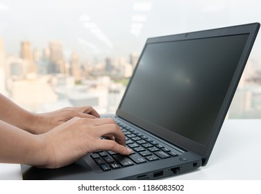 Woman hand is typing to the laptop keyboard