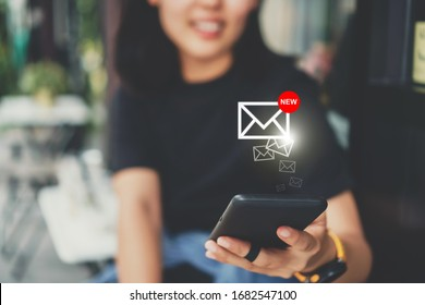 Woman hand use smartphone in public area with 1 new email alert sign icon pop up. Communication business technology concept.
