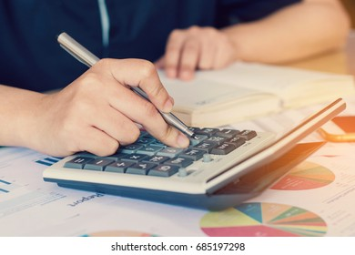 woman hand using calculator and writing make note with calculate