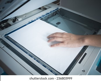 Woman hand using copy print machine