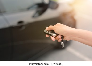 woman hand using interlock remote to open door of a car