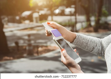 Woman hand using iphone mobile device for pay online with credit card