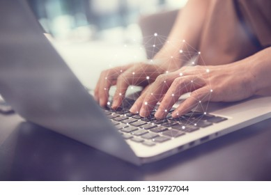 Woman hand using laptop device at co-working office, Social network concept.