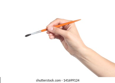 Woman hand using a little paintbrush isolated on a white background