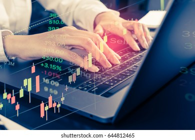Woman hand Using modern laptop to  view market indicator of investment graph and financial data, marketing analysis