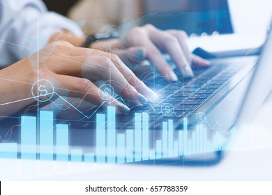 woman hand using modern laptop to invest in stock market with investment graph